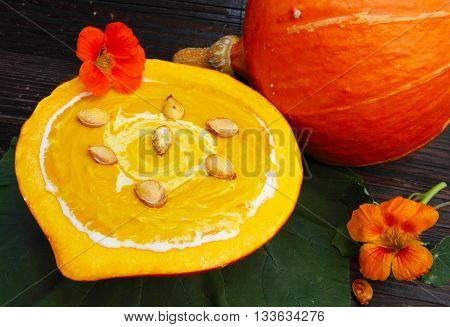 Cream of pumpkin soup with toasted pumpkin seeds
