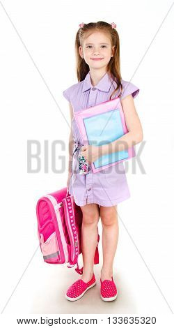 Portrait of smiling schoolgirl with books and backpack isolated on a white background