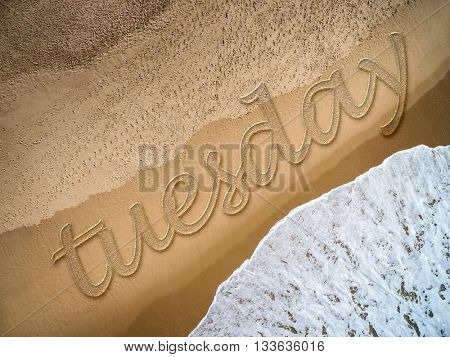 Tuesday written on the beach