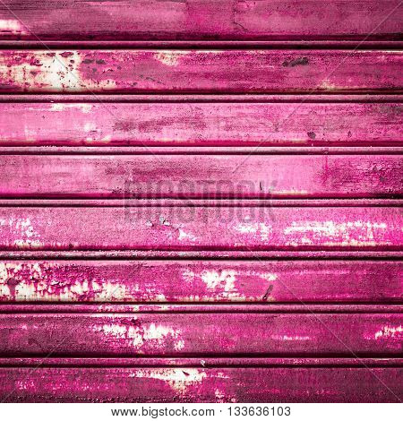 Retro colored background with noise effect; grunge texture with pink/fuchsia color pattern