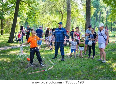 Zaporizhia/Ukraine- June 5, 2016: teen boy participating in beach rescue practice on charity family festival organized in regions with most quantity of refugees from Donetsk area, occasioned with International Children`s Day