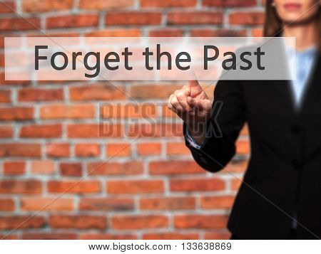 Forget The Past - Businesswoman Hand Pressing Button On Touch Screen Interface.