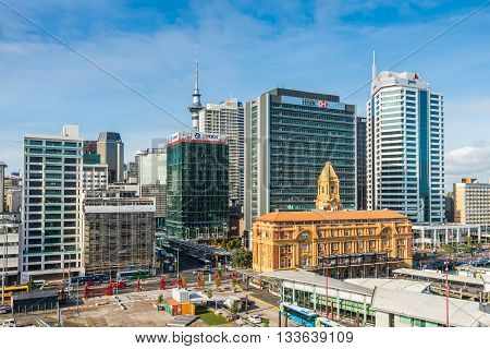 Auckland New Zealand - November 20 2014: Auckland Ferry Building Cruise Port terminal and city skyline. Auckland has been rated one of the world's top 10 cities to visit by travel bible Lonely Planet.