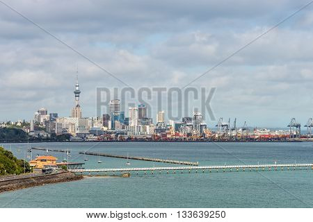 Auckland New Zealand - November 20 2014: Auckland downtown skyline with Jetty. Auckland has been rated one of the world's top 10 cities to visit by travel bible Lonely Planet.