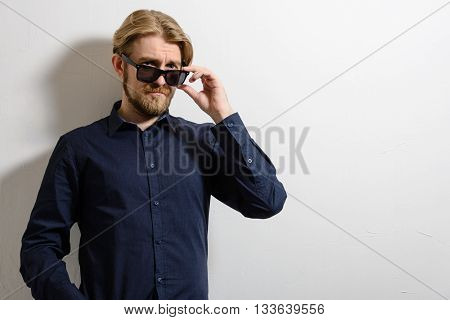 Portrait Of A Good Looking Young Man With Sunglasses