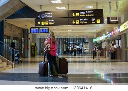 VALENCIA, SPAIN - JUNE 9, 2016: Airline passengers in the Valencia Airport. About 4.98 million passengers passed through the airport in 2015.