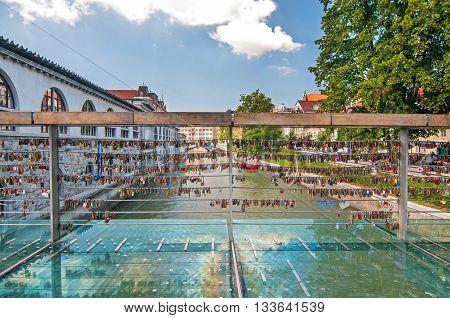 Love padlocks on Butcher's bridge on a bright sunny day Ljubljana Slovenia
