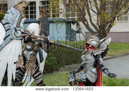 Two Cosplayers Dressed As The Characters Uriel And Haven  Paladin