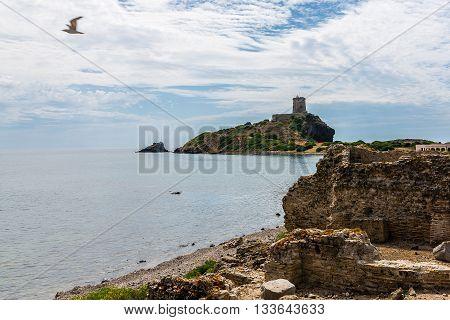 Ancient Sardinian ruins of Nora Sardinia ancient spanish tower of Coltellazzo Pula Sardegna Italy