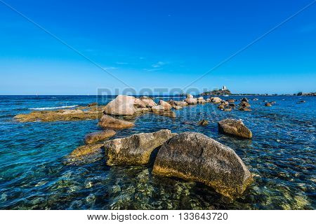 Sea Rocks And Tower In Nora Near Pula, Sardegna