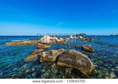 Sea Rocks And Tower In Nora Near Pula, Sardegna
