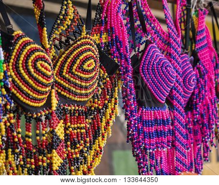 Traditional African colorful handmade beads clothes. Folk art. African market. Ethnic fashion. South Africa.