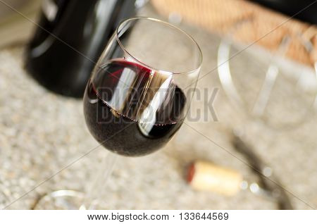 Glass of red wine on the table and corkscrew