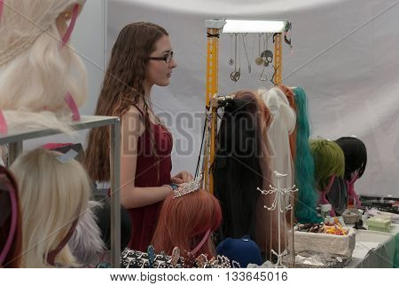 Saleswoman At Market With Anime Wigs  At Animefest