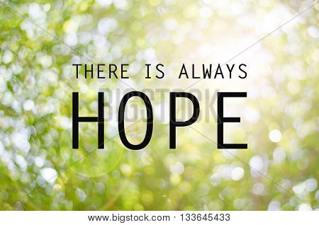 Inspirational Typographic Quote - There is always hope on bokeh background.