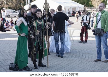 Cosplayers Dressed As The Character Lady Loki And Loki