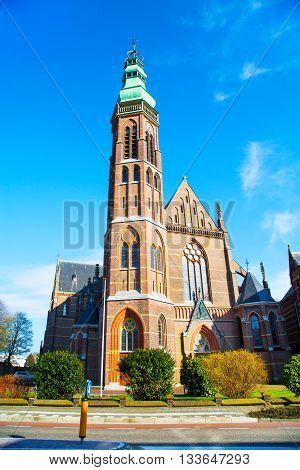 St. Agatha church in Lisse, the Netherlands, against blue sky