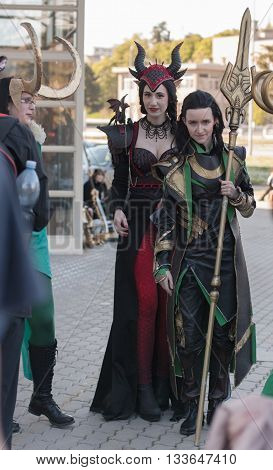 Two Cosplayers Dressed As Characters Ruby Dragon And Loki