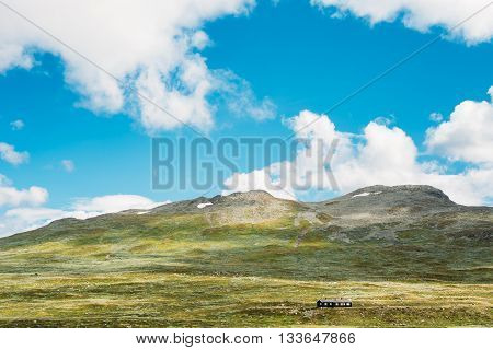 Wooden House On Norwegian Mountains Landscape. Nature Of Norway. Travel And Hiking. Amazing Scenic View At Sunny Summer Day. Nobody. Scandinavia. Blue Sky