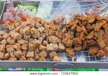 Deep fried crab meat rolls and deep frying fish cake for sale in market