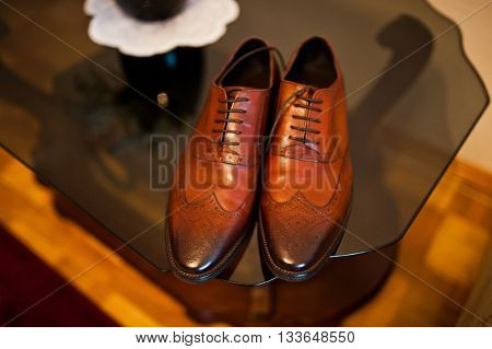Brown leather man shoes of groom indoor