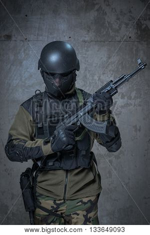 Terrorist In Helmet With Automatic Rifle In Hands