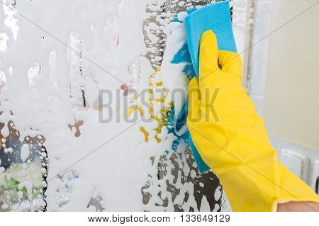 Housework Concept. Person Is Cleaning Mirror With Rag.