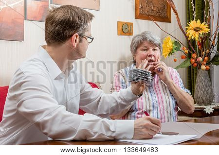Young Doctor shows senior their expensive medications.