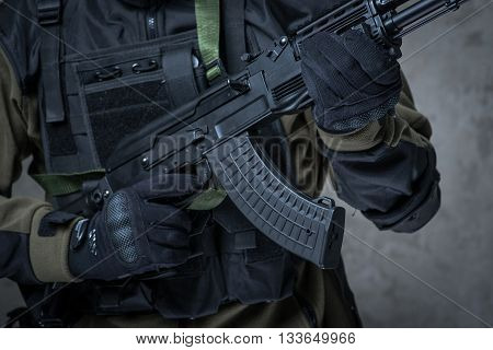Terrorist In Gloves With Automatic Rifle In Hands