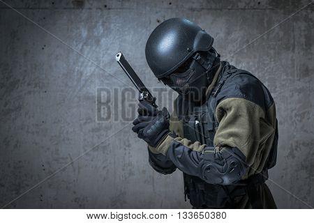 Terrorist In Helmet With Big Gun In Hands
