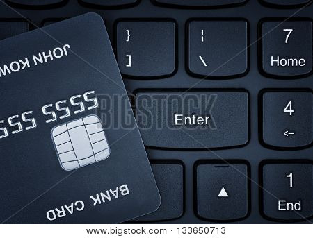 Online shopping. Credit card on a computer keyboard.