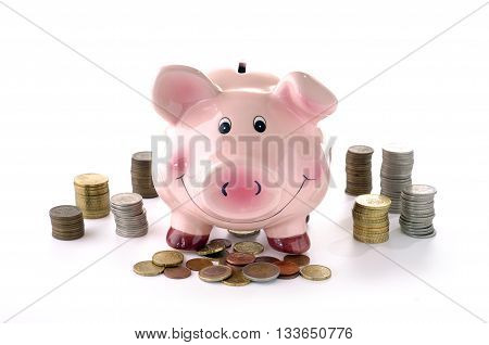 Pink piggy banks and coins on a white background