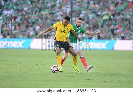 Lee Williamson And  Miguel Layun Fighting For The Ball