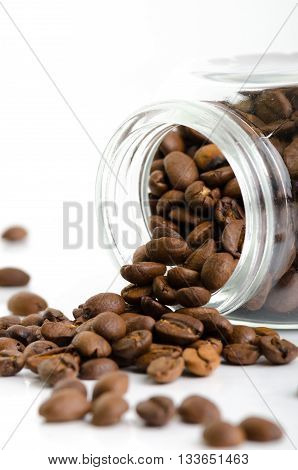 Jar with coffee beans bulk isolated on white background