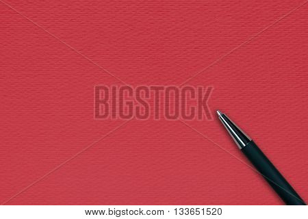 Red papper background with black ball pen and text space