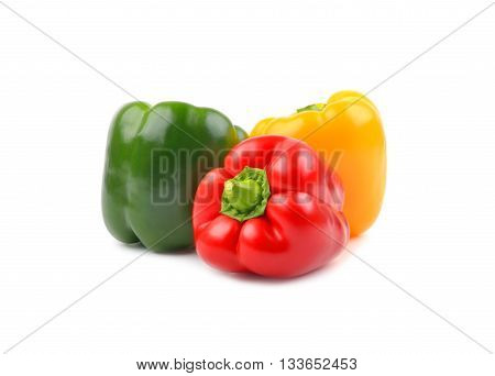 Three fresh sweet peppers isolated on white background