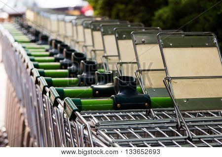 BEACONSFIELD ENGLAND - JUNE 2016: Waitrose shopping trollies outside store in Beaconsfield