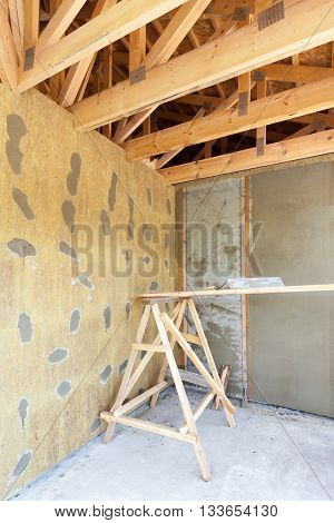 House under construction. Facade layers over insulation meshplaster cement mortar