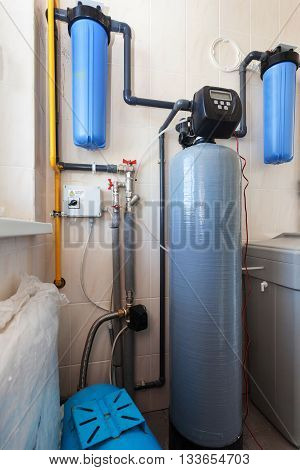 A boiler room with containers and pipes