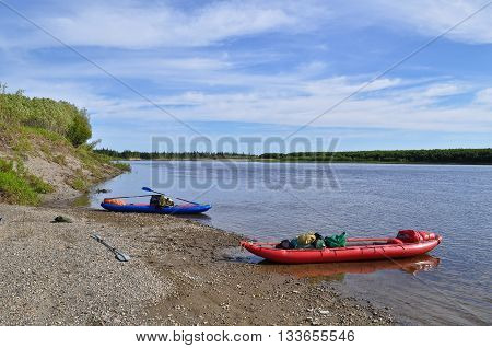 River landscape in the polar Urals with boats of tourists Republic of Komi Russia.