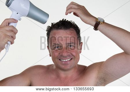 Smiling Man In His Bathroom On Morning With Hair Dryer