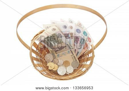 Basket with Russian coins and banknotes of different nominal.