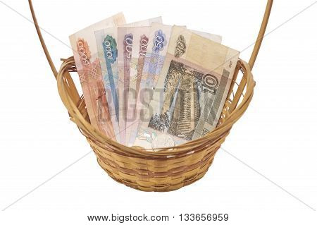 Basket with Russian banknotes and coin of different nominal.