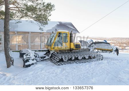Orel, Russia - January 10, 2016: Snowcat Bombardier BR-275 Snow Groomer - groomers machine for preparation of ski runs and ski slopes - parked in the ski park
