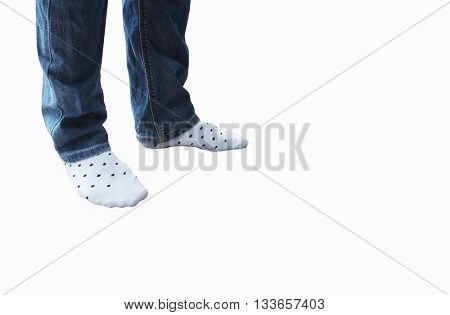 Legs in jeans and white socks with polka dot pattern isolated on white background