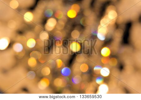 Blurred reflections of the light. Unfocused image of multi-colored light sources.