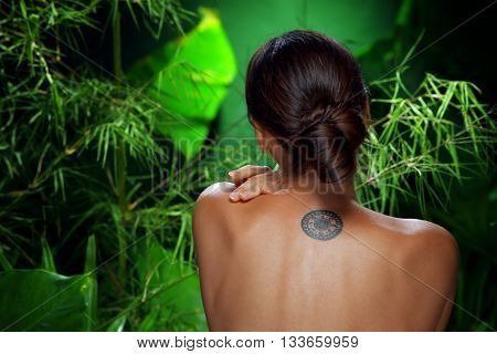 Close up portrait of young beautiful woman in spa environment