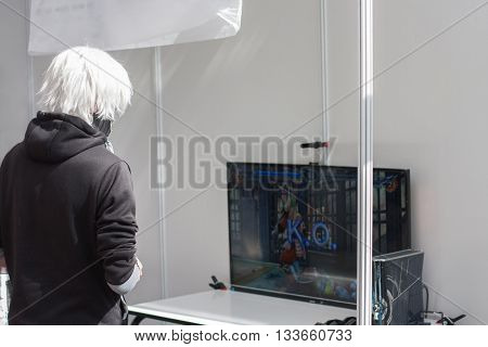 Unidentified Teenager Playing Console Games At Animefest