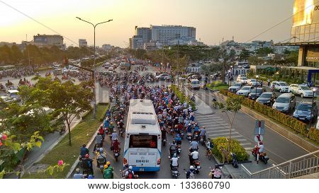 Ho-Chi-Minh-City (Saigon), Vietnam, 21st March 2016. Traffic jam at evening rush hour while sunset. Streets are filled with an uncountable number of motorbikes, cars, bus and trucks.
