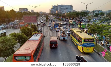 Ho-Chi-Minh-City (Saigon), Vietnam, 21st March 2016. Every evening at sunset the streets of that asian mega-city are filled with an uncountable number of motorbikes, cars, bus and trucks.